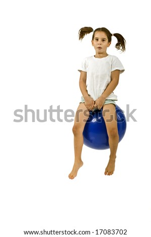 young girl on a  blue space hopper isolated on white