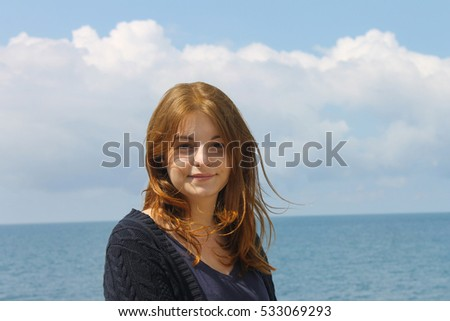 Young girl on sea background