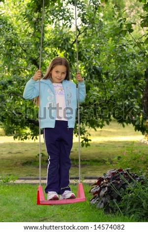 Young girl on the garden swing