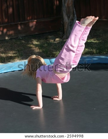 young girl on trampoline