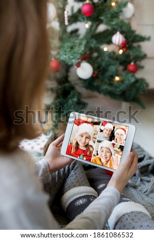 Young girl on video call with family during Christmas holiday