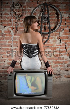 young girl on vintage TV receiver. expressed face