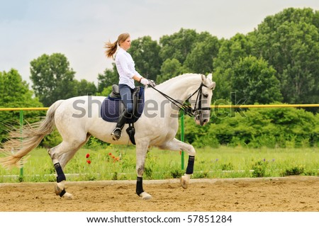 Young girl on white dressage horse
