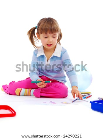 young girl painting a picture on paper