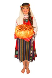 Young girl peasant with traditional Bulgarian folklore costume and sourdough bread in hand portrait isolated