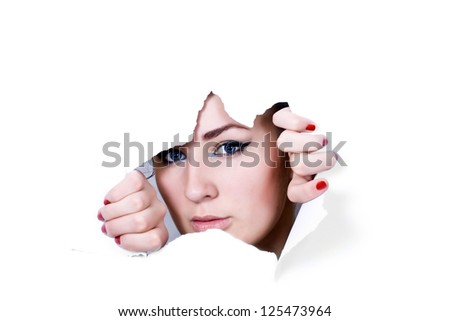 young girl peeping through hole in paper