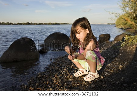 Young Girl Playing by the Columbia River in the Evening Sun