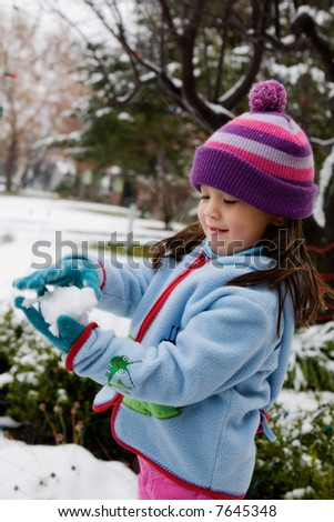 Young Girl Playing in Snow.  Hands in motion.