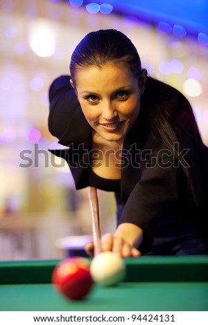 Young girl playing snooker