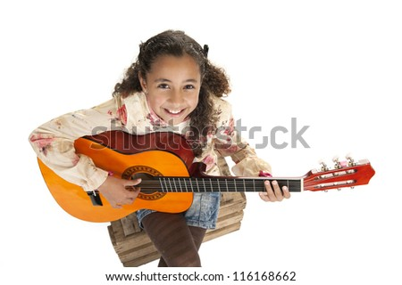 young girl playing the guitar, isolated on white