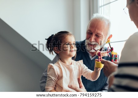 Young girl playing with a new toy Foto stock ©