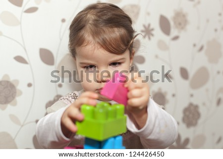young girl playing with blocks - stock photo