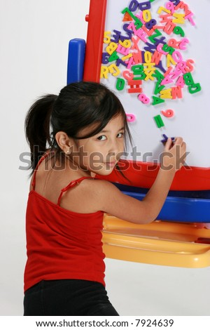 Young girl playing with letters