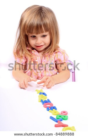 Young girl playing with letters and numbers for early childhood development