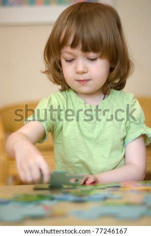 Young Girl Playing With Puzzle