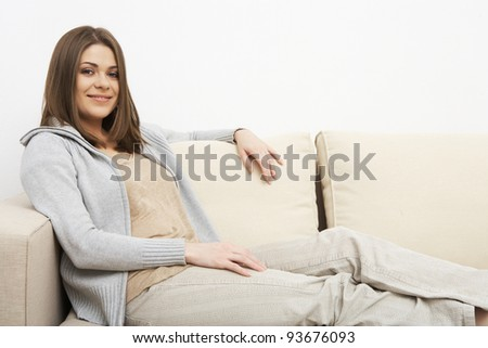 young girl portrait sitting on a sofa. indoor relax at home. beautiful woman