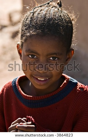 Young girl portrait , social issues, poverty, village near Kalahari desert