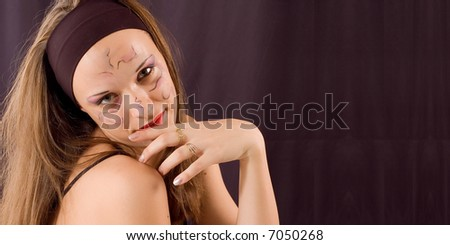 Young girl portrait with drawn ornament on face