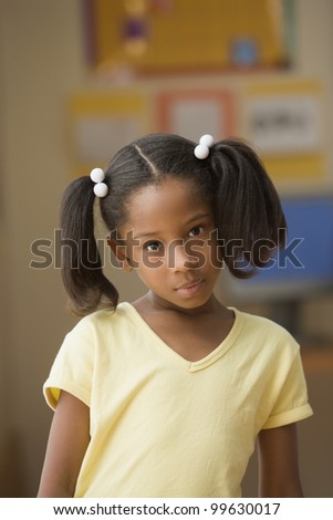 Young girl posing for the camera - stock photo