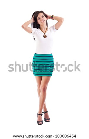 Young girl posing in short skirt. Isolated over white background