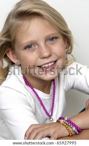 Young girl posing on a white background