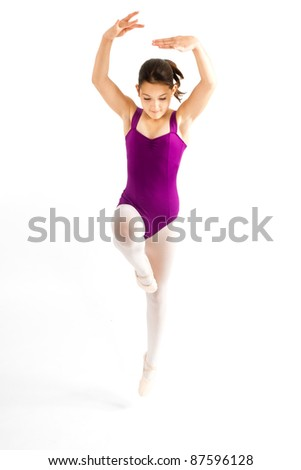 Young girl practicing her ballet.