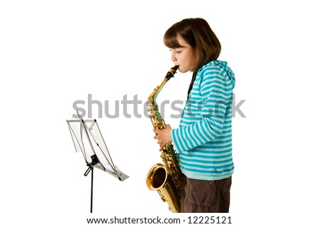Young girl practising the saxophone against a white background