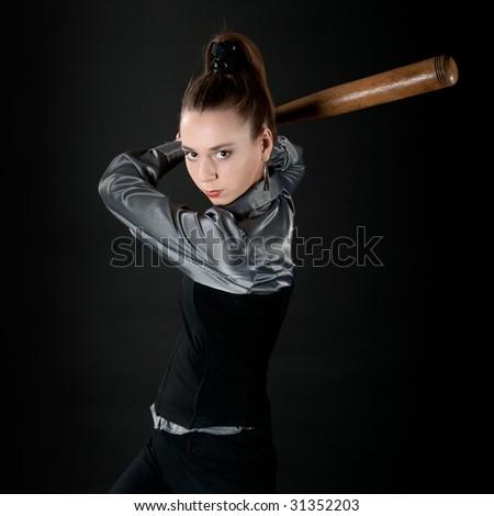 Young girl prepares to strike by baseball bat