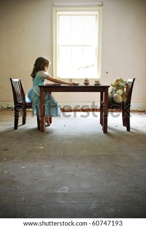 Young girl pretending to have tea with her stuffed rabbit/Tea Time with Alice