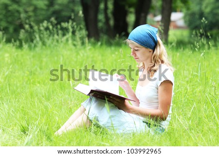 young girl reading the Bible