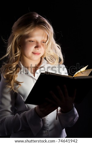 young girl reads book