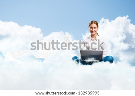 young girl running in the clouds with a laptop, take off from the notebook paper