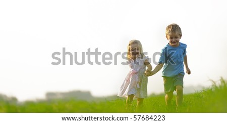 stock photo : Young girl runs through a field, happy and having fun.