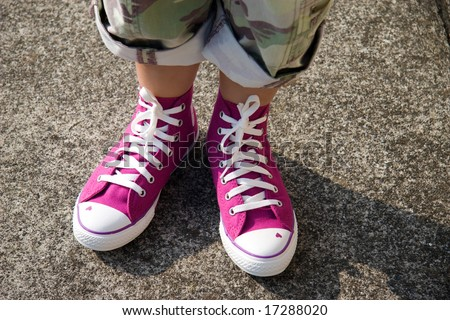 Young girl's feet with pink shoes and military capri's