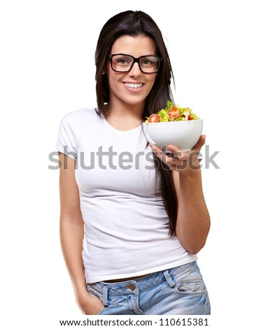 Young Girl Showing A Bowl Of Salad Isolated On White Background