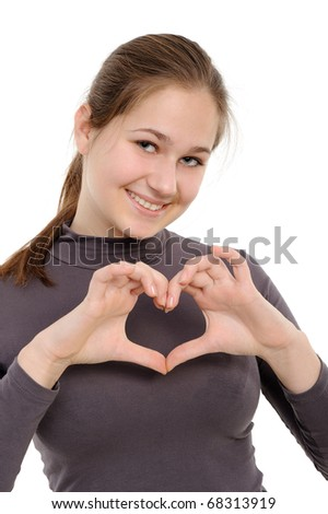 "Young girl showing ""heart"" with her fingers. Isolated on white background"