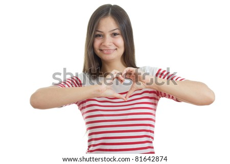 """Young girl showing """"heart"""" with her fingers. Isolated on white background"""