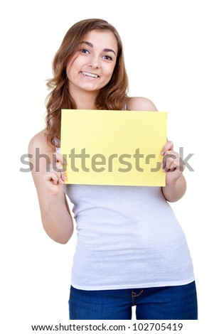 young girl shows empty sheet of a yellow paper. Isolation on the white