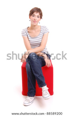 young girl sitting isolated on white