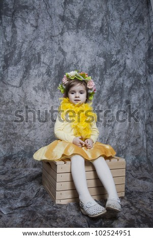 Young girl sitting on a stool
