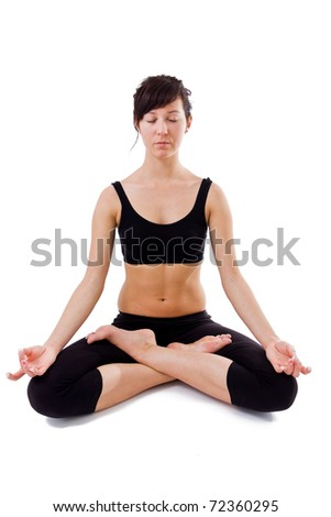 Young girl sitting on the white background doing yoga
