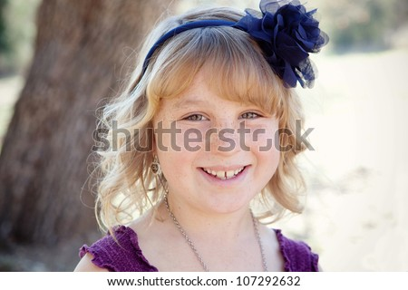 Young girl smiling for a portrait