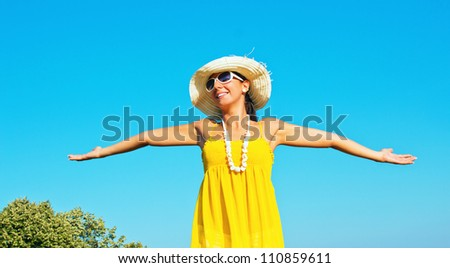 Young girl spreading hands with joy and inspiration