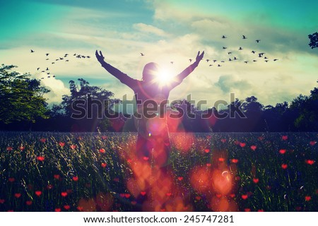 Young girl spreading hands with joy and inspiration facing the sun,sun greeting,freedom concept,bird flying above sign of freedom and liberty,heart bokeh