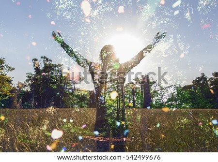 Young girl spreading hands with joy and inspiration facing the sun,sun greeting,freedom concept, nature lover ,spirit of forest  #542499676