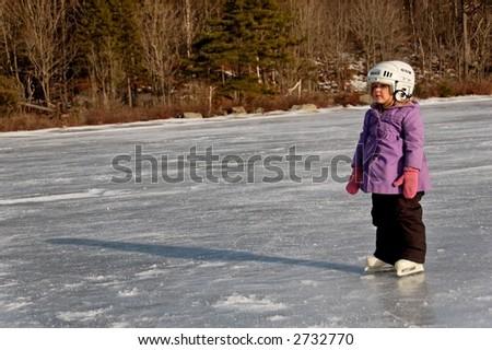 young girl standing on ice lake