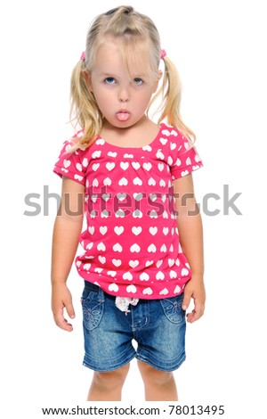 young girl sticks out tongue while isolated on white in studio