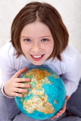 Young girl studying geography with an earth globe