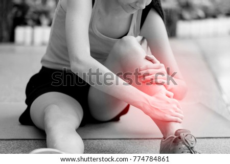 Young girl suffering or injury leg after do yoga.  russian woman or student has pain in his foot or shin while exercise or warm up. sport woman runner hurting holding painful sprained  ankle in pain - Shutterstock ID 774784861