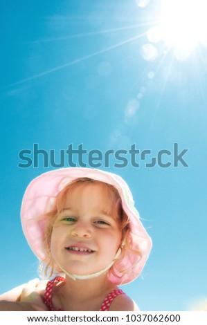 Young Girl Sunbathing In Hat Zdjęcia stock ©